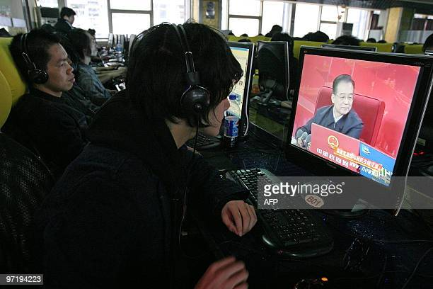 Websurfer watches Chinese Premier Wen Jiabao making comments during an online chat with Internet users shown live on the central government's website...