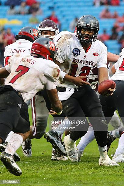 North Carolina State Wolfpack quarterback Jacoby Brissett hands off to wide receiver Nyheim Hines during the first half of the Belk Bowl between NC...
