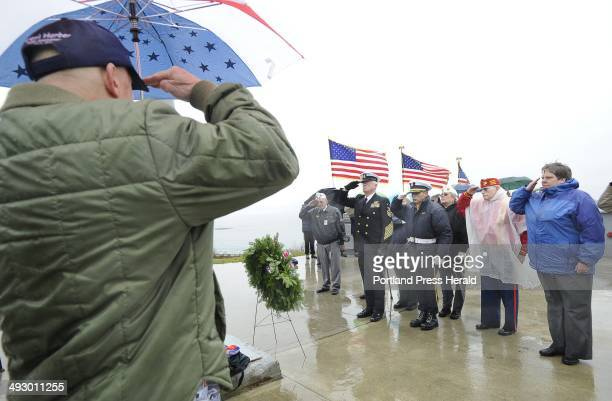 Wed. , Dec. 7, 2011. Local veterans salute after they laid a wreath in rememberance of the 70th anniversary of the Japanese attack on Pearl Harbor...