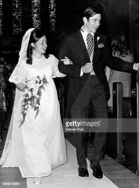 Wed Saturday In Episcopal Rites Newlywed Mr and Mrs Edward Howland Wood Jr hurry to a waiting limousine which took them to their wedding ' reception...