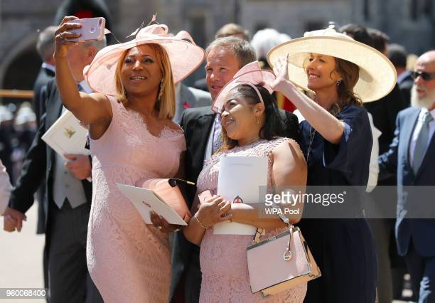 Weddding guests take a selfie outside St George's Chapel at Windsor Castle after the wedding of Prince Harry to Meghan Markle on May 19 2018 in...