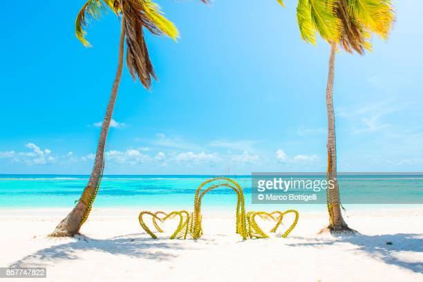 Wedding arch on tropical beach. Dominican Republic.