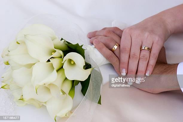 Wedding bands and hands