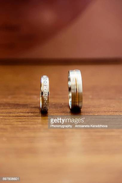 wedding bands made from white and yellow gold - white gold stock pictures, royalty-free photos & images
