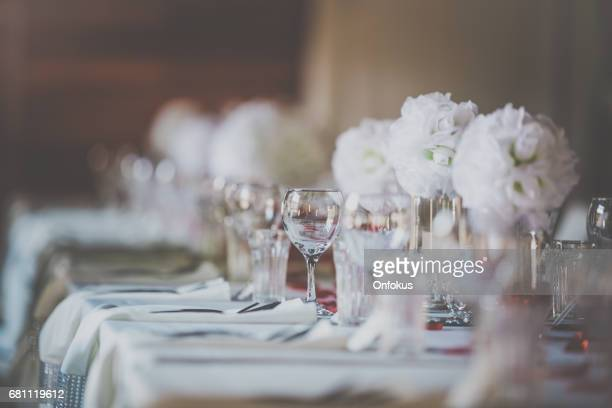 wedding birthday reception decoration, chairs, tables and flowers - ornato foto e immagini stock