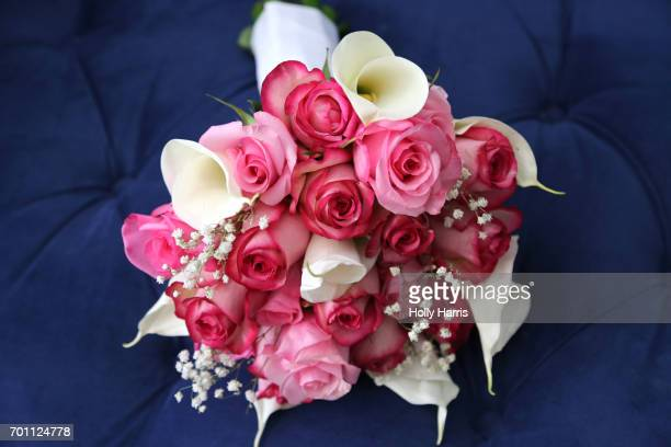 Wedding bouquet of pink and red roses, blue background
