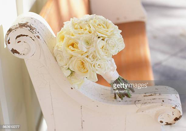 Wedding bouquet on a wooden bench