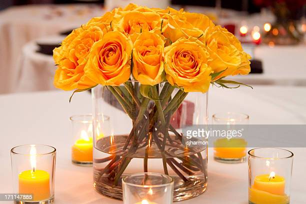 Wedding Bouquet on Table with Votive Candles Yellow Flowers