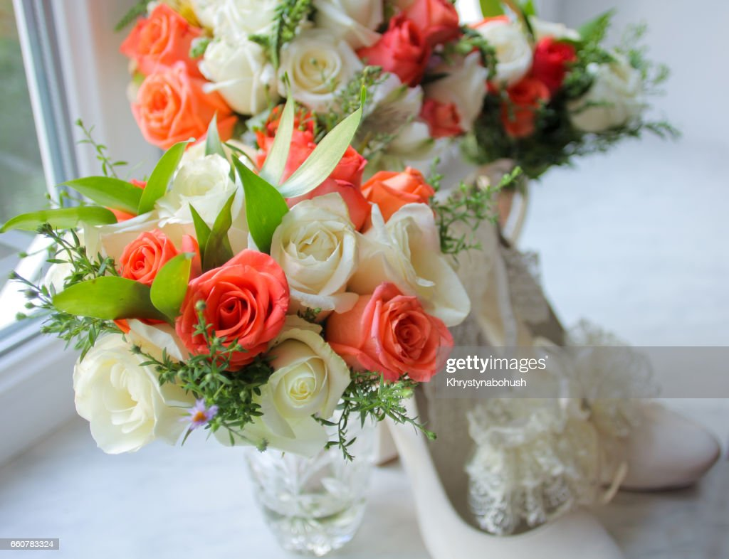 Wedding Bouquet With Orange And White Roses On Windowsill Stock