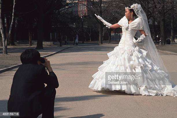 A wedding bride being photographed at Toksugung Palace near City Hall in Seoul