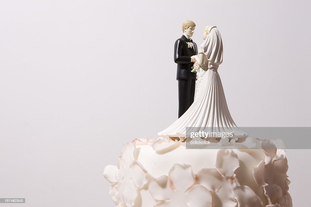 Wedding cake and bride and groom cake topper : Stock Photo