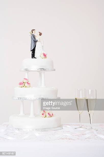 wedding cake and champagne - wedding cake figurine stock pictures, royalty-free photos & images