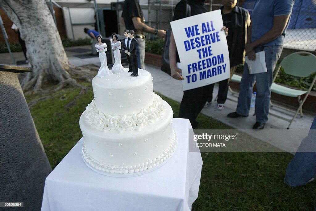 A wedding cake featuring two brides and two grooms is on display during a rally celebrating marriage equality and recognizing the issuance of same sex marriage licenses in Massachusetts in West Hollywood, CA 19 May 2004. Massachusetts is the first state to issue such licences as the controversy continues among legislators and politicians.