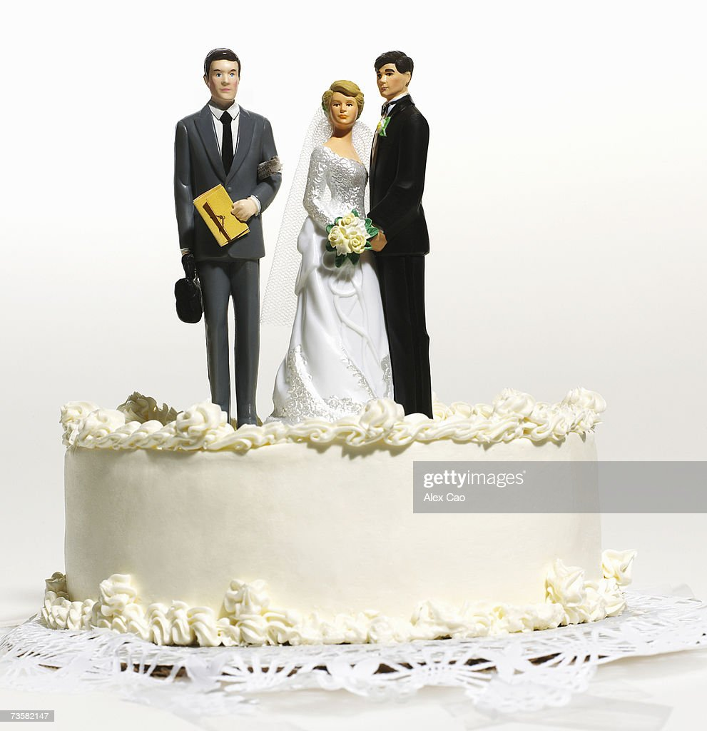 Wedding cake top with groom, bride, and lawyer : Stock Photo