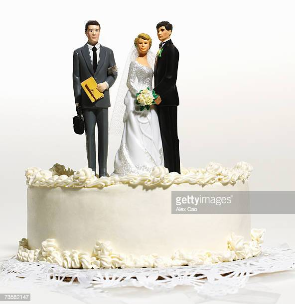 Wedding cake top with groom, bride, and lawyer
