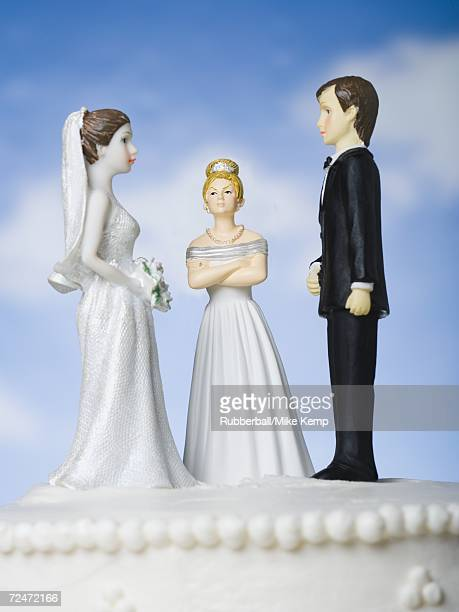 wedding cake visual metaphor with figurine cake toppers - mother in law stock pictures, royalty-free photos & images