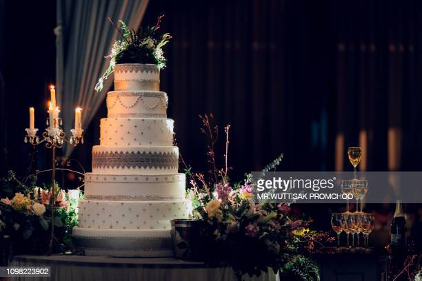 wedding cake with champagne glass tower  in the banquet room. - tower stock pictures, royalty-free photos & images