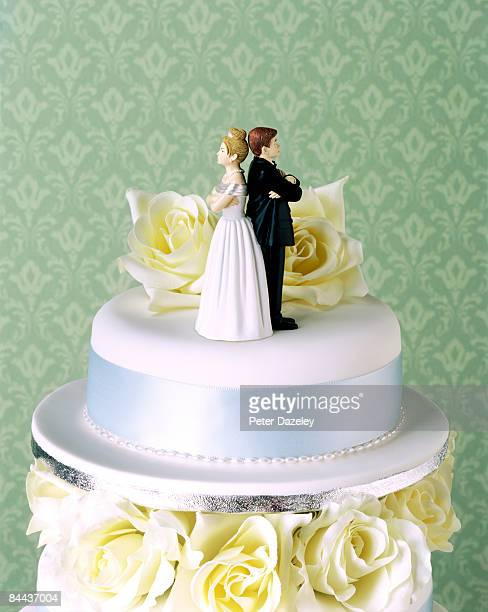 Wedding cake with couple having argument