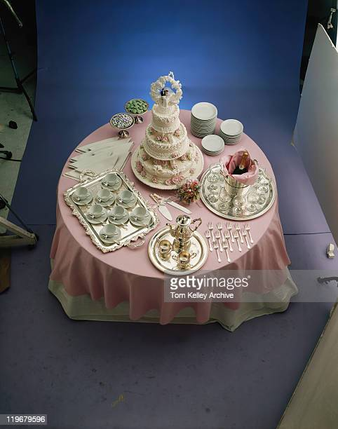 Wedding cake with place setting on dining table