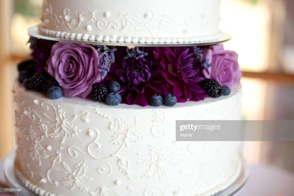 Wedding Cake With Purple Flowers Stock Photo