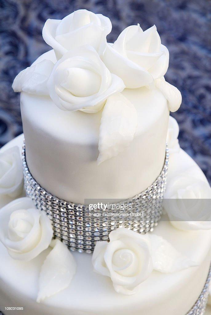 Wedding Cake With Rhinestones And White Roses Close Up Stock Photo