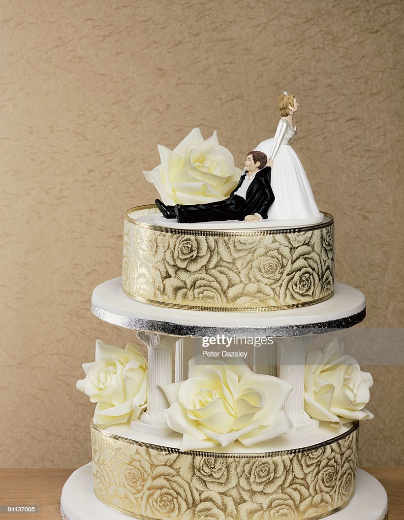 Wedding Cake With Wife Dragging Husband Stock Foto