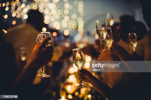 wedding celebratory toast with string lights and champagne silhouettes - political party stock pictures, royalty-free photos & images