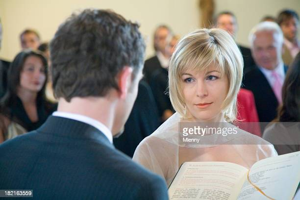 wedding ceremony bride and groom in church - wedding vows stock pictures, royalty-free photos & images