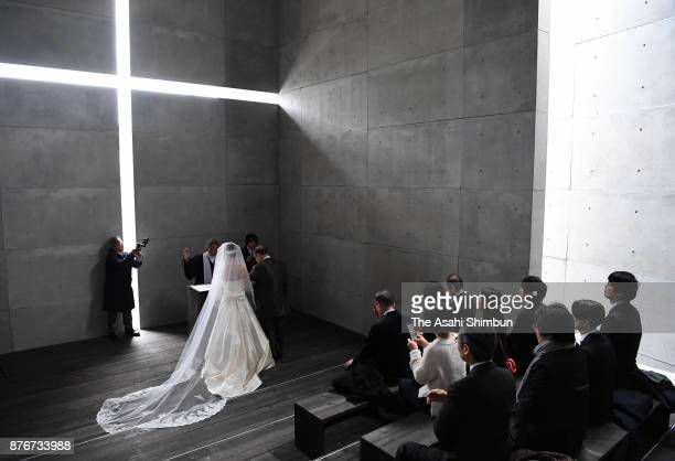 A wedding ceremony is held at a reproduction of Tadao Ando's Church of the Light at the National Art Center on November 19 2017 in Tokyo Japan The...