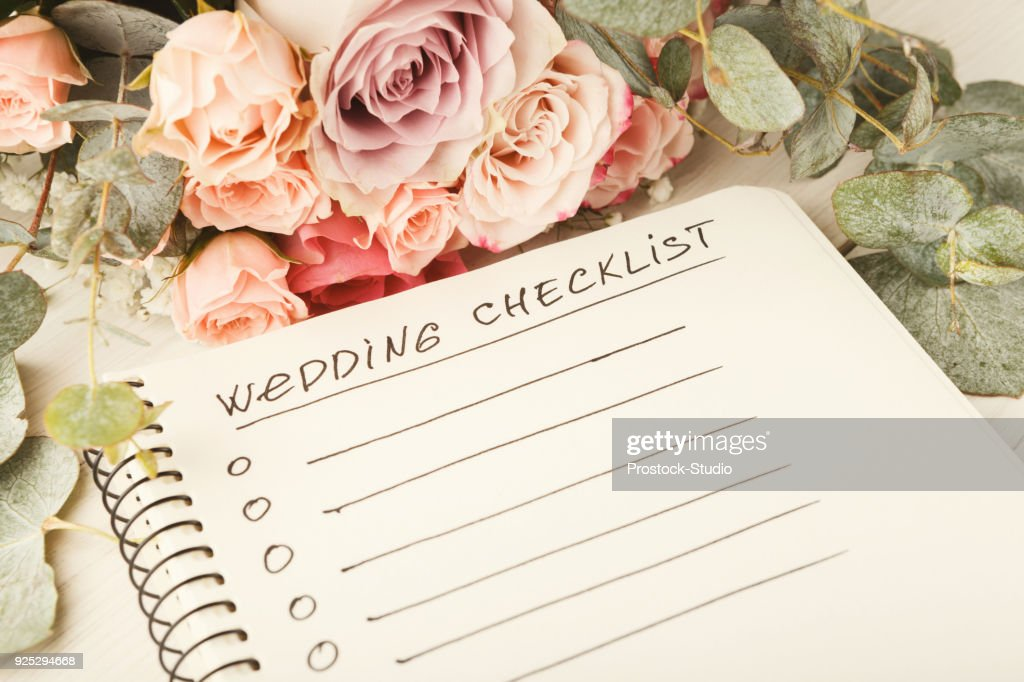 Wedding checklist and rose bouquet : Stock Photo