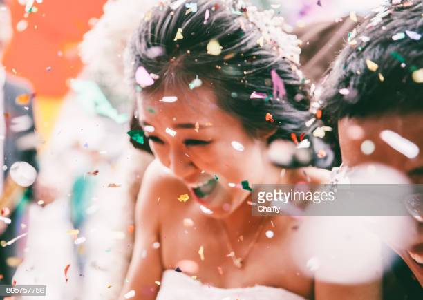 wedding confetti bride and groom - wedding ceremony stock photos and pictures