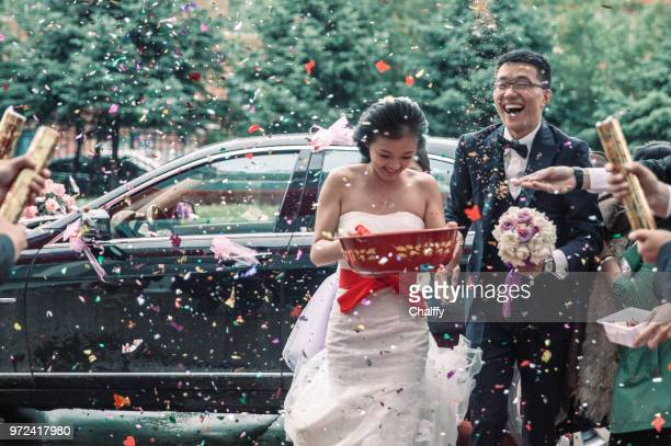 wedding confetti bride and groom - chinese culture stock pictures, royalty-free photos & images