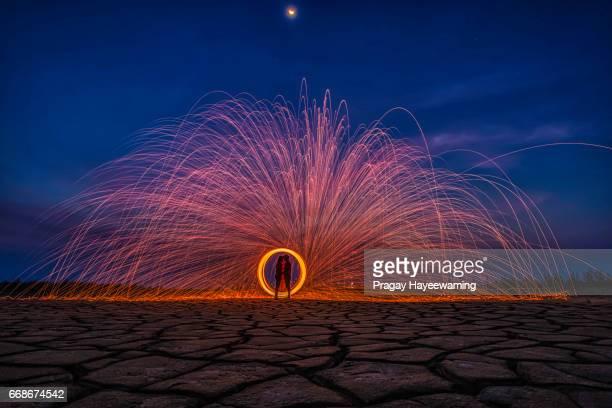Wedding couple Burning steel wool fireworks.
