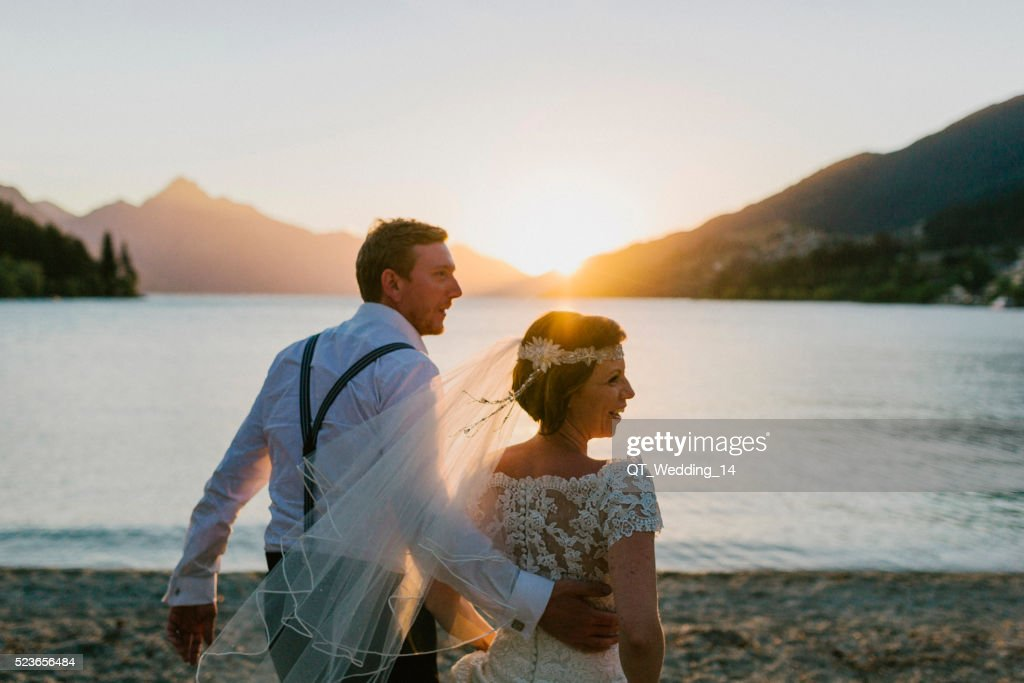 Wedding Couple by Queenstown Lake at Sunset : Stock Photo