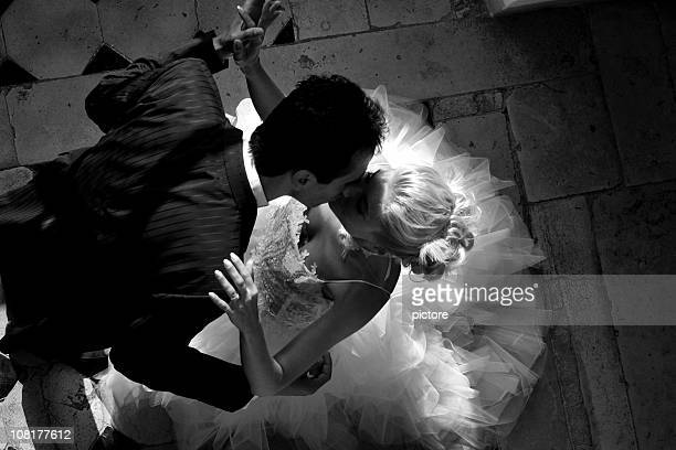 Wedding couple dancing and Kissing