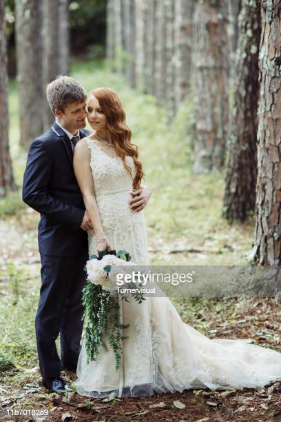 Wedding Couple Embracing In Forest