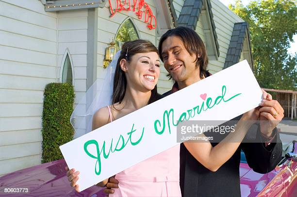 Wedding couple holding Just Married sign