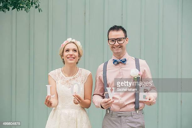 Wedding couple holding LOVE word