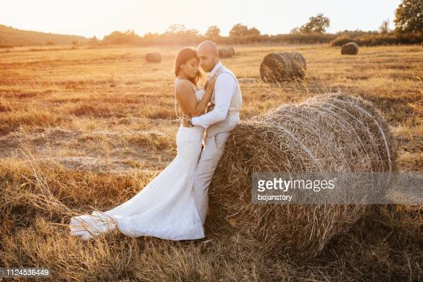 Wedding couple in a hay field