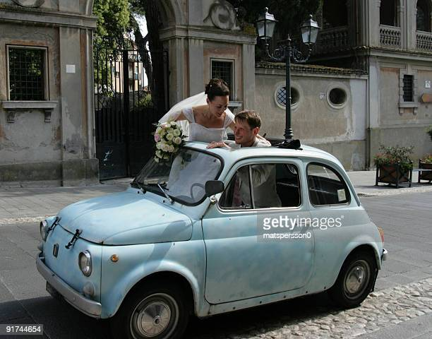Wedding couple in their car