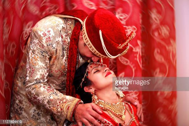 wedding couple posing - hinduism stock pictures, royalty-free photos & images