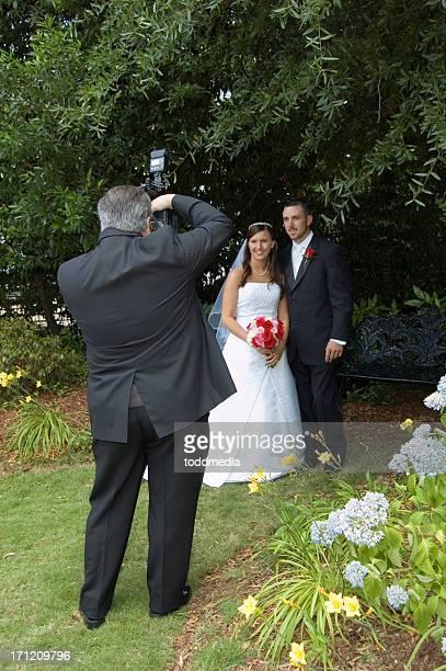 Wedding couple taking photos