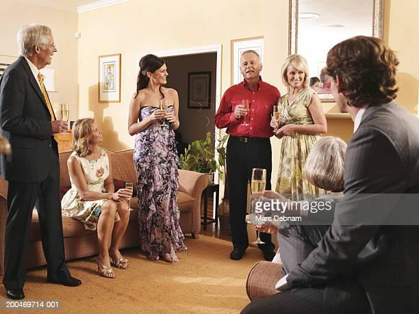 wedding couple with guests, indoors - mittelgroße personengruppe stock-fotos und bilder