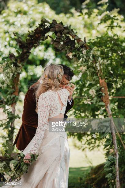 wedding day celebrations - natural arch stock pictures, royalty-free photos & images