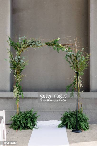 Wedding Day Ceremonial Arch made of fern, florals and greenery