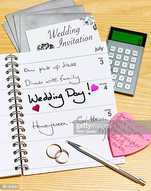 wedding day in diary - time management stock photos and pictures