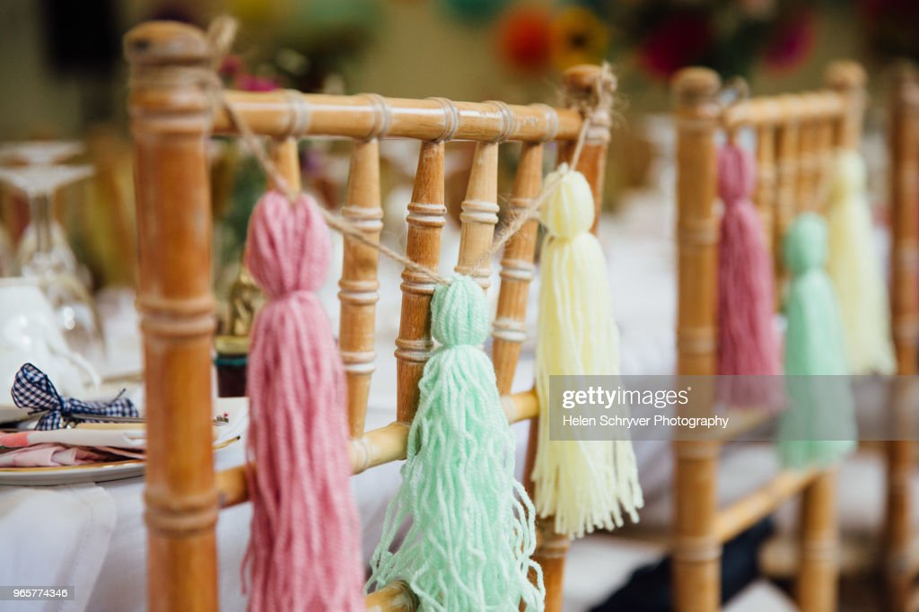 Wedding Decor Pastel Coloured Tassles On Chair Close Up Stock Photo