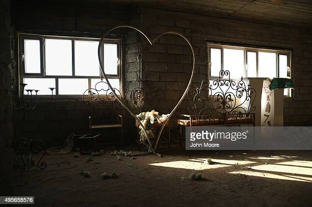 Wedding decorations sit idle in the attic of a marriage hall now used as a military hospital on November 4, 2015 near the frontline with ISIS...