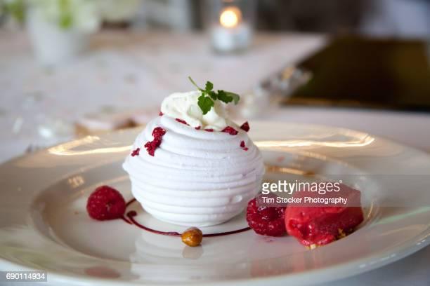 Wedding Desert, meringue filled with ice cream and raspberries.