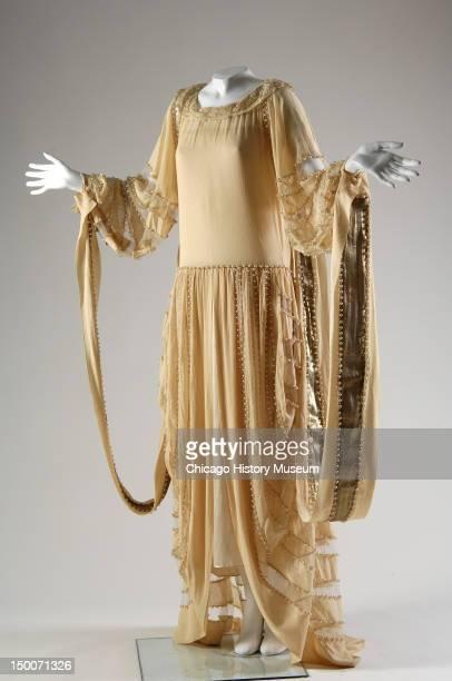 Wedding dress, 1924 . Silk crepe, lace, lame, pearls, net by Jeanne Lanvin.